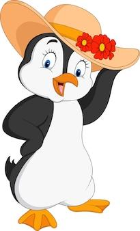 Pingouin de dessin animé portant la paille d'été