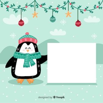 Pingouin fond noël tenant une pancarte blanche