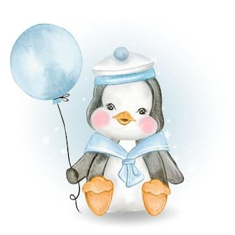 Pingouin mignon bébé avec uniforme marin tenant le ballon