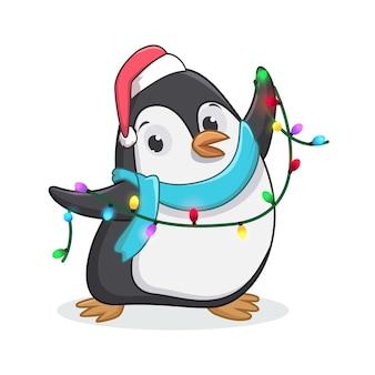 Pingouin mignon avec des lumières de décoration de noël