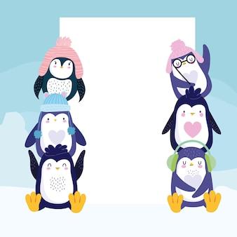Pingouins mignons avec des chapeaux