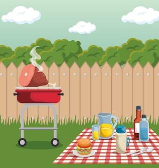 Pique-nique et barbecue à l'arrière avec clôture
