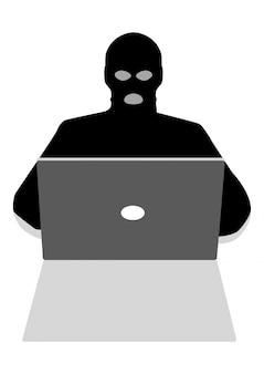 Pirate informatique derrière un ordinateur portable