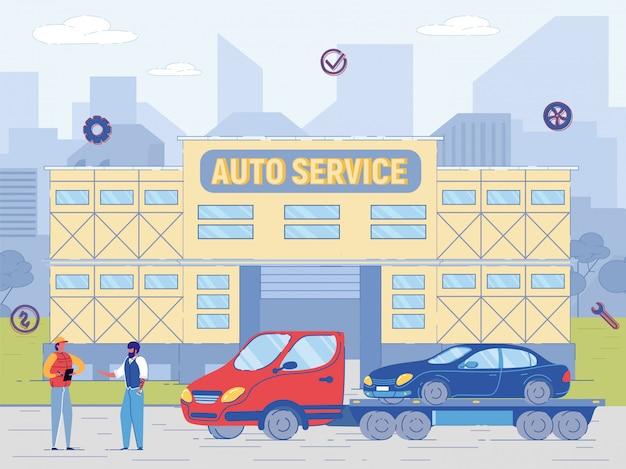 Piste de remorquage avec voiture près du bâtiment de service automobile