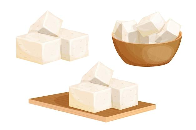 Placez des morceaux de tofu dans un bol en bois sur un bureau de coupe en style cartoon