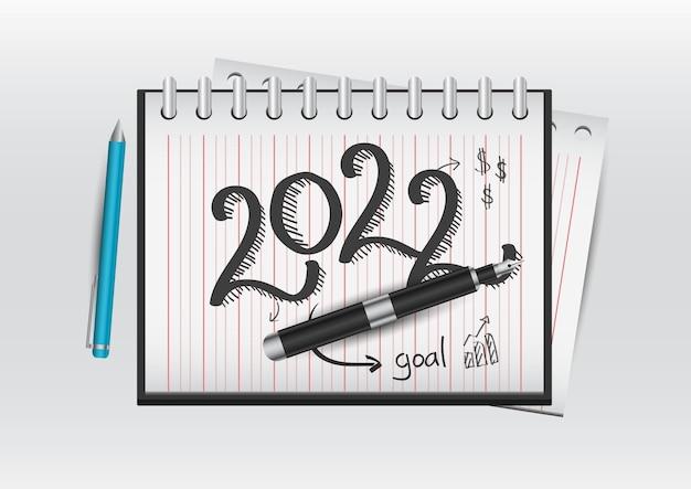 Plan pour le nouvel an 2022 mots écrits dans un cahier de bureau le concept des objectifs commerciaux