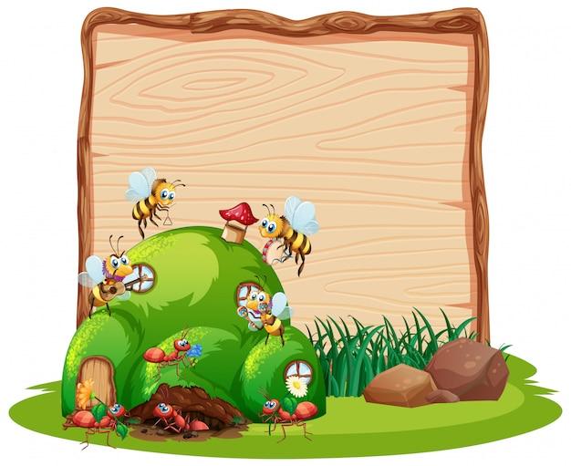 Planche de bois vierge dans la nature avec jardin animal isolé