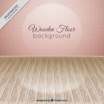 Plancher en bois avec des briques roses mur