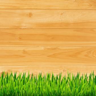 Planches de bois avec fond d'herbe verte