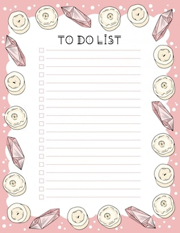 Planificateur hebdomadaire hygge et liste de choses à faire avec des bougies et des cristaux de quartz.