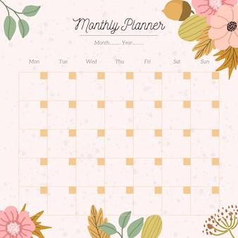 Planificateur mensuel avec fond floral d'automne