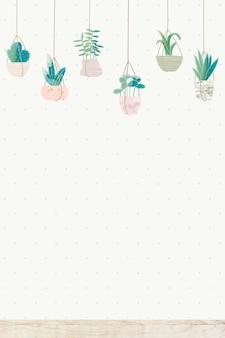 Plantes suspendues sur fond de mur blanc
