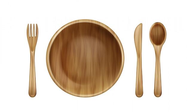 Plaque en bois, fourchette, cuillère et couteau vue de dessus.