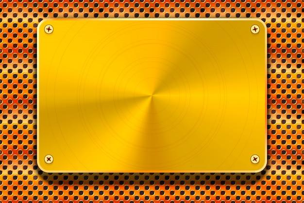 Plaque de métal doré brillant sur grille de cuivre, fond industriel