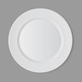 Plaque ronde plate vide blanche isolée, vue du dessus