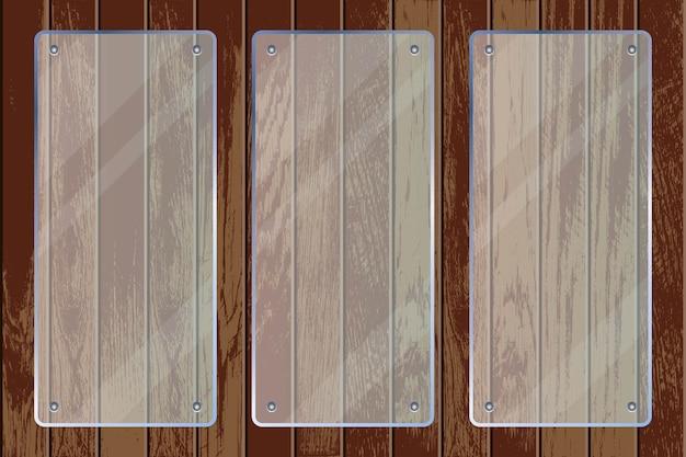 Plaques de verre transparent sur fond texturé en bois