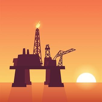 Plate-forme pétrolière au coucher du soleil