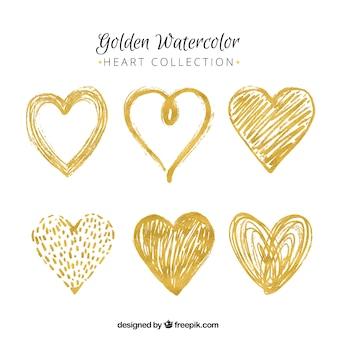Plusieurs coeurs dorés peints à l'aquarelle