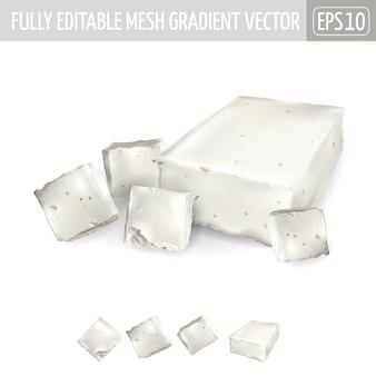 Plusieurs morceaux de fromage feta sur fond blanc.