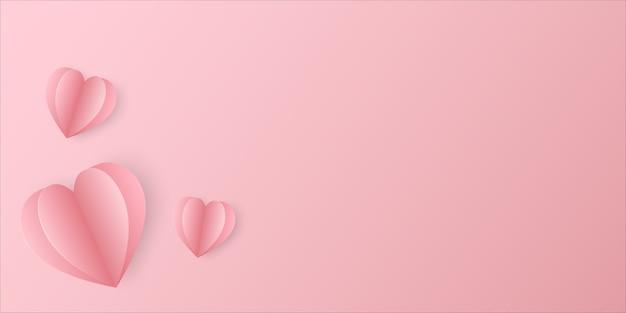 Plusieurs papiers découpés en forme de coeur placés sur un beau fond dégradé rose