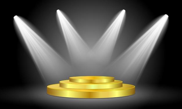 Podium rond en argent éclairé par des projecteurs isolés sur fond noir