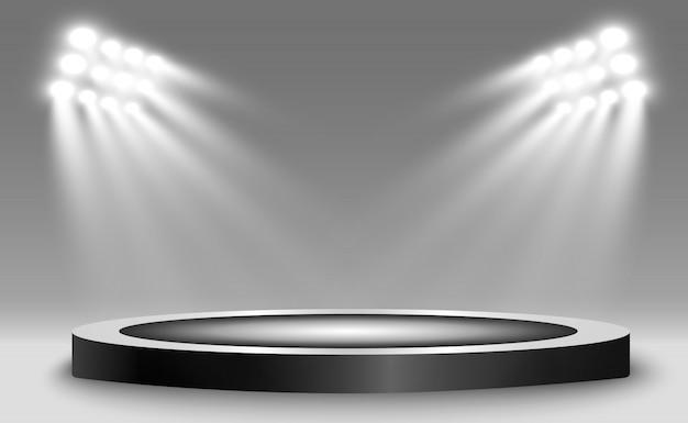 Podium rond, piédestal ou plateforme, éclairé par des projecteurs en arrière-plan.