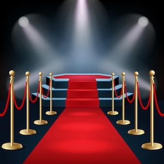 Podium avec tapis rouge et barrière de sécurité à la lueur des projecteurs