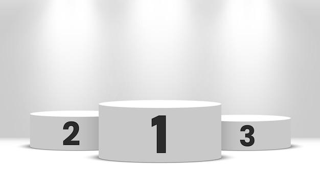 Podium des vainqueurs de la ronde blanche avec des projecteurs. piédestal.