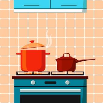 Le poêle avec un anneau allumé et une casserole bouillante dessus et un seau avec couvercle sur l'autre anneau