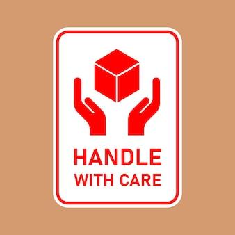 Poignée de colis fragile avec logistique de soins et étiquette d'expédition de livraison