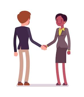 Poignée de main homme d'affaires et femme d'affaires