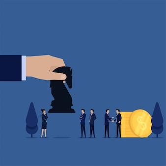 Poignée de main homme d'affaires avec pièces et main donne cheval noir à la métaphore de l'équipe d'acquisition.