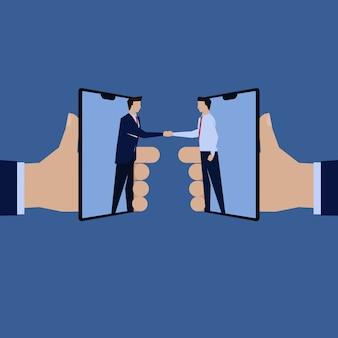 Poignée de main homme d'affaires référence de récompense de téléphone mobile en ligne.