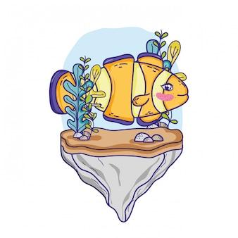 Poisson clown dans la pierre avec algues