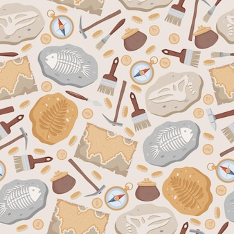 Poissons fossiles et dinosaures squelettes cartes boussole pièces de monnaie brosses et
