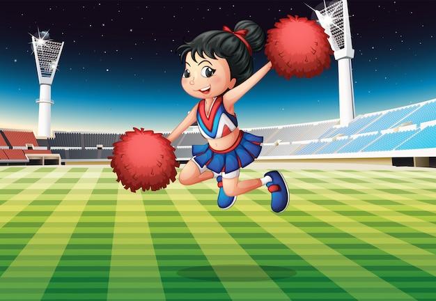 Une pom-pom girl se produisant au stade