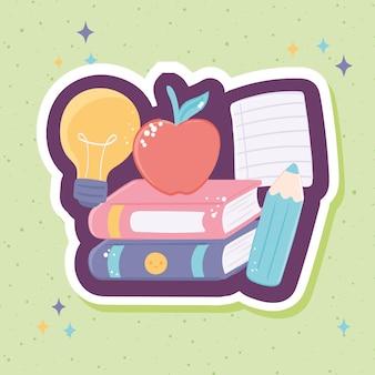 Pomme et crayon de livres scolaires
