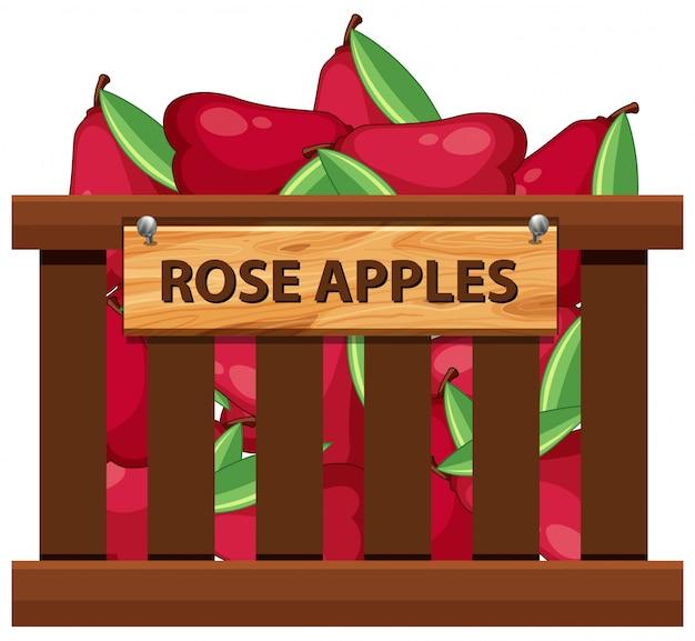Pomme rose dans une caisse en bois