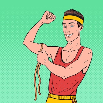 Pop art funny sportsman mesure ses muscles