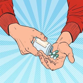 Pop art man tenant une bouteille avec des médicaments médicaux. mains mâles avec des pilules. supplément pharmaceutique.