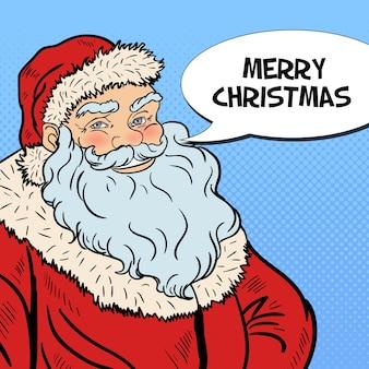 Pop art souriant père noël souhaitant joyeux noël dans la bulle de dialogue comique. illustration