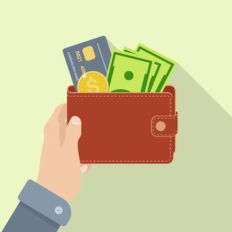 Portefeuille avec argent de poche, carte de crédit. sac à main avec de l'argent en main