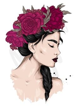 Portrait d'une belle fille dans une couronne de fleurs