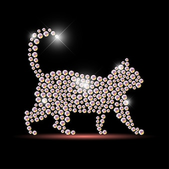 Portrait de chat fait avec des pierres précieuses en strass isolé sur fond noir. logo animal, icône de l'animal. modèle de bijoux, produit fabriqué à la main. motif brillant. silhouette animale, marche pour animaux de compagnie.