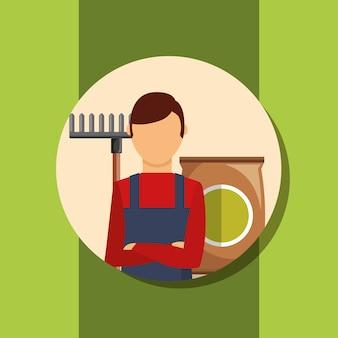 Portrait d'homme jardinier avec râteau et terreau