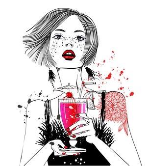 Portrait de jeune femme avec cocktail à la main