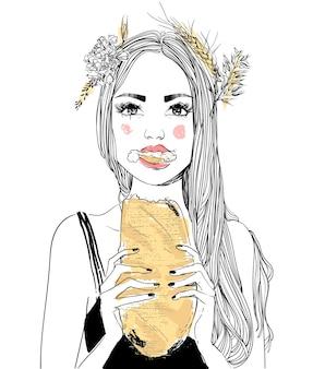 Portrait de jeune femme avec du pain dans les mains