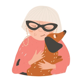 Portrait de vieille dame ou femme tenant son chien teckel et étreindre.
