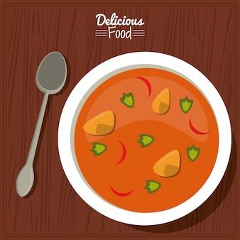 Poster couverts avec plat de soupe aux légumes