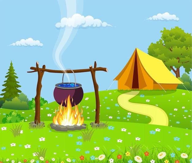 Pot de camping noir sur un feu de joie